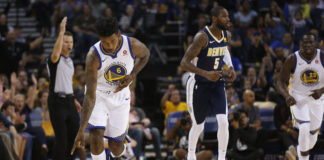 Golden State Warriors guard Nick Young (6) reacts after making a three point basket against the Denver Nuggets in the second quarter at Oracle Arena.