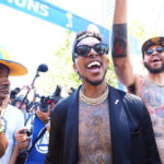 Golden State Warriors guard Nick Young (middle) and center JaVale McGee (right) celebrate during the championship parade in downtown Oakland.