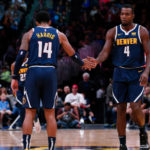 Denver Nuggets guard Gary Harris (14) reacts with forward Paul Millsap (4) after a play in the third quarter against the New Orleans Pelicans at the Pepsi Center.