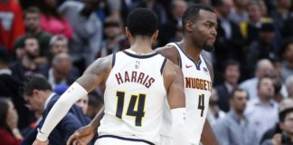 Denver Nuggets forward Paul Millsap (4) is congratulated by guard Gary Harris (14) after scoring game winning points in overtime against the Chicago Bulls at United Center.
