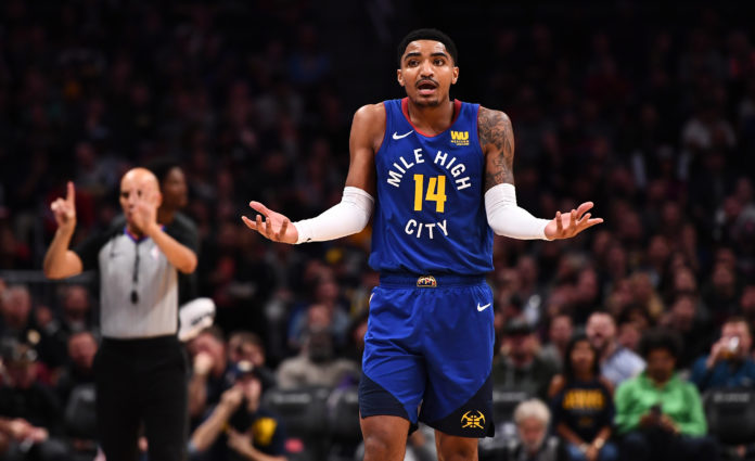 Denver Nuggets guard Gary Harris (14) reacts to consecutive fouls called on him during the second half against the Brooklyn Nets at the Pepsi Center.