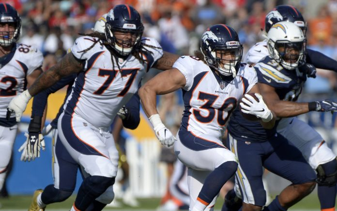 Phillip Lindsay runs away from defenders. Credit: Jake Roth, USA TODAY Sports.