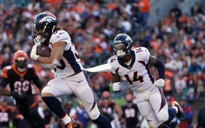 Phillip Lindsay and Courtland Sutton run. Credit: Aaron Doster, USA TODAY Sports.