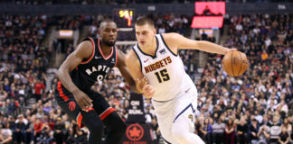 Denver Nuggets center Nikola Jokic (15) drives past Toronto Raptors forward Serge Ibaka (9) in the second quarter at Scotiabank Arena.