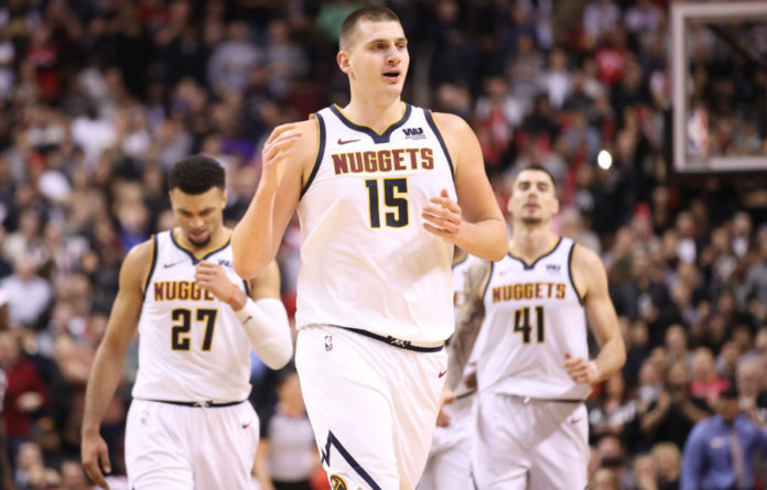 Denver Nuggets center Nikola Jokic (15) celebrates after scoring a basket late in the fourth quarter against the Toronto Raptors at Scotiabank Arena. The Nuggets beat the Raptors 106-103.
