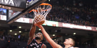 Toronto Raptors forward Serge Ibaka (9) dunks to tie the game in the fourth quarter against Denver Nuggets center Nikola Jokic (15) at Scotiabank Arena. The Nuggets beat the Raptors 106-103.