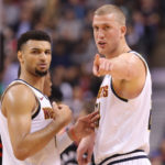Denver Nuggets forward Mason Plumlee (24) talks to guard Jamal Murray (27) against the Toronto Raptors at Scotiabank Arena. The Nuggets beat the Raptors 106-103.