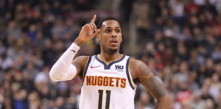 Denver Nuggets guard Monte Morris (11) reacts during their game against the Toronto Raptors at Scotiabank Arena. The Nuggets beat the Raptors 106-103.