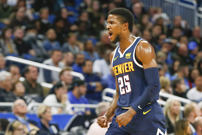 Denver Nuggets guard Malik Beasley (25) celebrates a three point basket during the second half against the Orlando Magic at Amway Center.