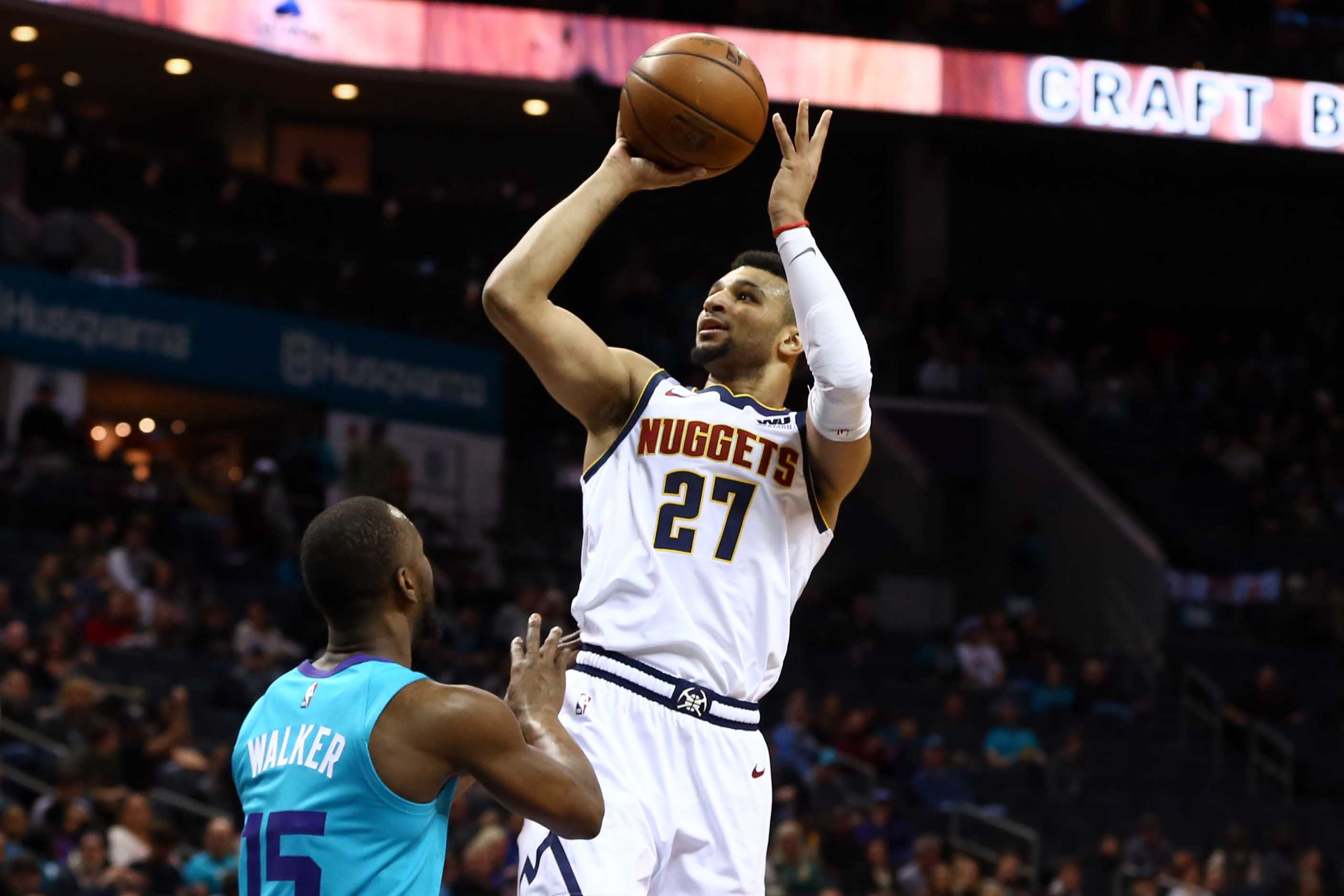 Denver Nuggets guard Jamal Murray (27) shoots the ball over Charlotte Hornets guard Kemba Walker (15) in the first half at Spectrum Center.
