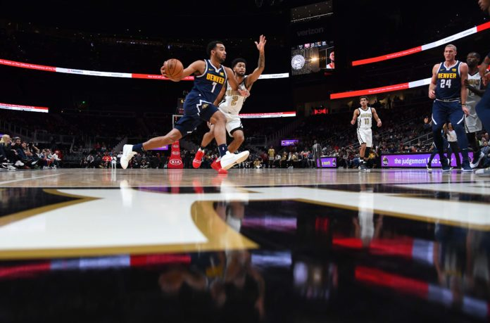 Denver Nuggets forward Trey Lyles (7) drives to the basket as he is defended by Atlanta Hawks guard Tyler Dorsey (2) during the first half at State Farm Arena.