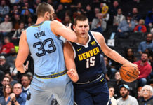 Memphis Grizzlies center Marc Gasol (33) elbows Denver Nuggets center Nikola Jokic (15) in the chin in the first quarter at the Pepsi Center.