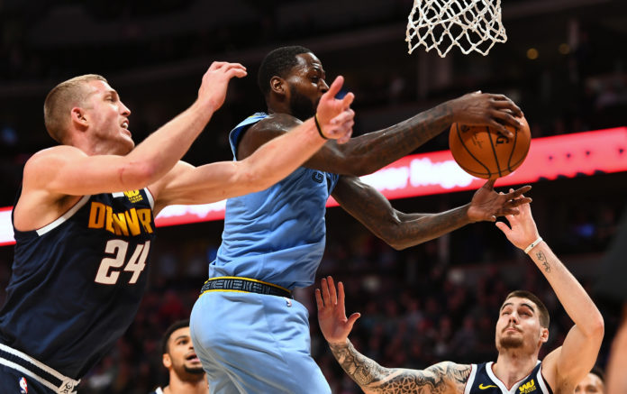 Dec 10, 2018; Denver, CO, USA; Memphis Grizzlies forward JaMychal Green (0) and Denver Nuggets forward Mason Plumlee (24) and forward Juan Hernangomez (41) go for a rebound in the second half at the Pepsi Center. Mandatory Credit: Ron Chenoy-USA TODAY Sports