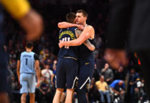 Denver Nuggets center Nikola Jokic (15) and forward Juan Hernangomez (41) celebrate the win over the Memphis Grizzlies at the Pepsi Center.