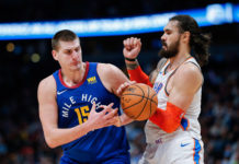 Oklahoma City Thunder center Steven Adams (12) defends against Denver Nuggets center Nikola Jokic (15) in the second quarter at the Pepsi Center.