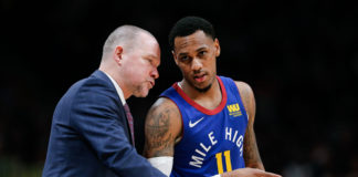 Denver Nuggets head coach Michael Malone talks with guard Monte Morris (11) in the third quarter against the Oklahoma City Thunder at the Pepsi Center.