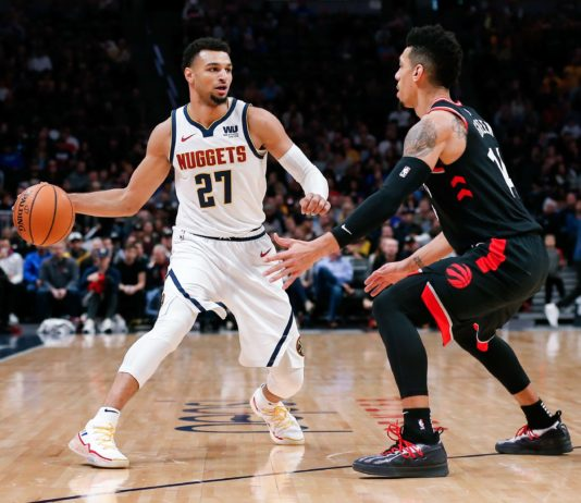 Toronto Raptors guard Danny Green (14) guards Denver Nuggets guard Jamal Murray (27) in the first quarter at the Pepsi Center.