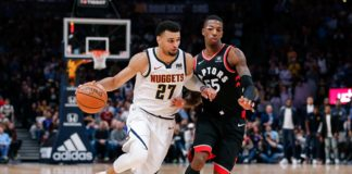 Toronto Raptors guard Delon Wright (55) guards Denver Nuggets guard Jamal Murray (27) in the fourth quarter at the Pepsi Center.