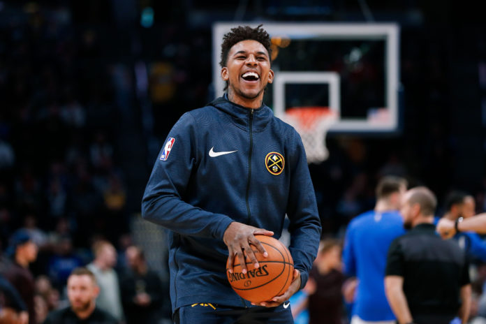 Denver Nuggets guard Nick Young (34) warms up before the game against the Dallas Mavericks at the Pepsi Center.