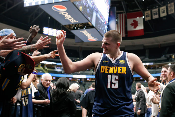 Denver Nuggets center Nikola Jokic (15) celebrates coming off the court after the game against the Dallas Mavericks at the Pepsi Center.