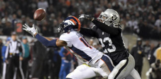 Denver Broncos wide receiver Courtland Sutton (14) catches a pass against Oakland Raiders cornerback Nick Nelson (23) in the first half at Oakland Coliseum.