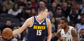 Denver Nuggets center Nikola Jokic (15) posts up against San Antonio Spurs power forward LaMarcus Aldridge (12) during the first half at AT&T Center.