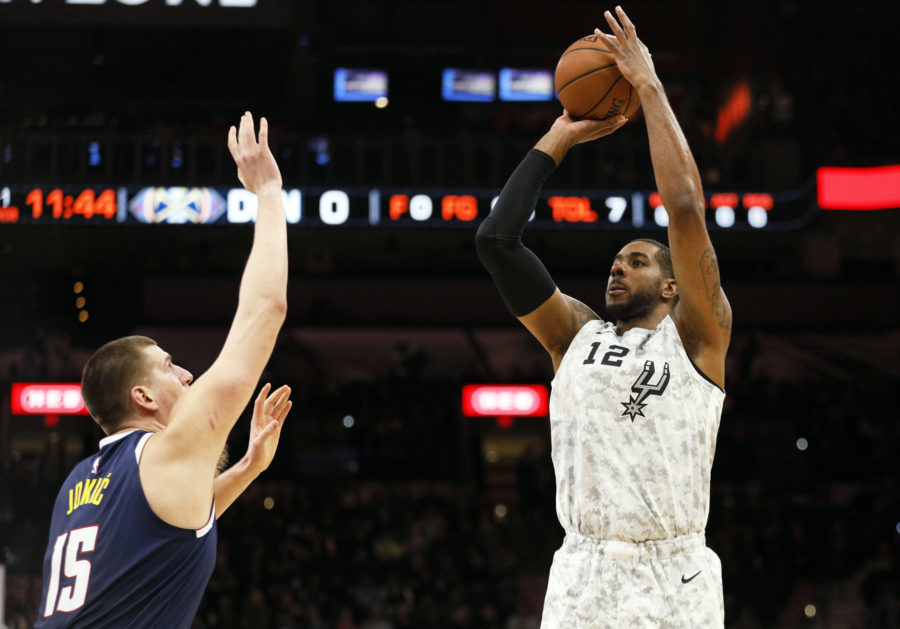 San Antonio Spurs power forward LaMarcus Aldridge (12) shoots the ball over Denver Nuggets center Nikola Jokic (15) during the first half at AT&T Center.
