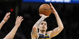 Denver Nuggets power forward Juan Hernangomez (41) shoots the ball over San Antonio Spurs point guard Derrick White (not pictured) during the second half at AT&T Center.