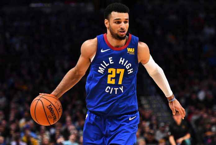 Denver Nuggets guard Jamal Murray (27) controls the ball during the second half against the San Antonio Spurs at the Pepsi Center.