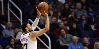 Denver Nuggets guard Jamal Murray (27) shoots against the Phoenix Suns during the first half at Talking Stick Resort Arena