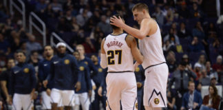 Denver Nuggets center Nikola Jokic (15) celebrates with Denver Nuggets guard Jamal Murray (27) during the second half against the Phoenix Suns at Talking Stick Resort Arena.