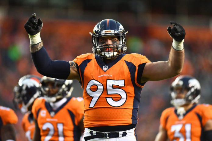 Denver Broncos defensive end Derek Wolfe (95) attempts to rally the crowd in the second half against the Cincinnati Bengals at Sports Authority Field at Mile High.