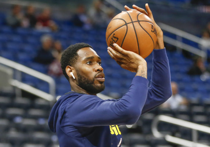 Denver Nuggets guard Will Barton (5) shoots a warmup shot before the game against the Orlando Magic at Amway Center.