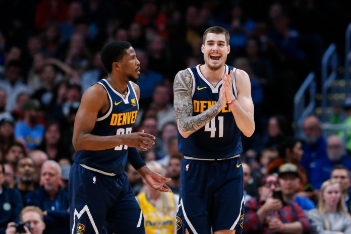 Denver Nuggets forward Juancho Hernangomez (41) reacts with guard Malik Beasley (25) after a play in the second quarter against the Dallas Mavericks at the Pepsi Center.