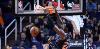 Phoenix Suns center Deandre Ayton (22) dunks against the Denver Nuggets during the second half at Talking Stick Resort Arena.