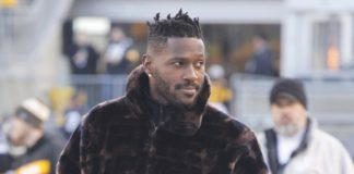 Antonio Brown, in Week 17, standing on the sideline with a fur coat on. Credit: Charles LeClaire, USA TODAY Sports.