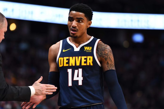Denver Nuggets guard Gary Harris (14) leaves the court in the second quarter against the Charlotte Hornets at the Pepsi Center.