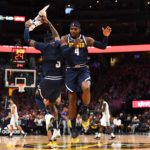 Denver Nuggets forward Paul Millsap (4) celebrates with forward Torrey Craig (3) after a timeout called by the Charlotte Hornets at the Pepsi Center.