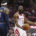 Houston Rockets guard James Harden (13) reacts while Denver Nuggets forward Paul Millsap (4) looks on after a play during the first quarter at Toyota Center.