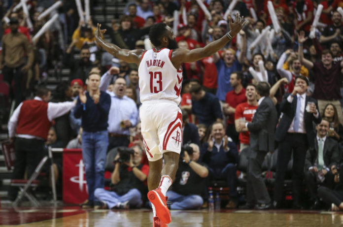 Houston Rockets guard James Harden (13) celebrates after scoring a basket during the second quarter against the Denver Nuggets at Toyota Center.