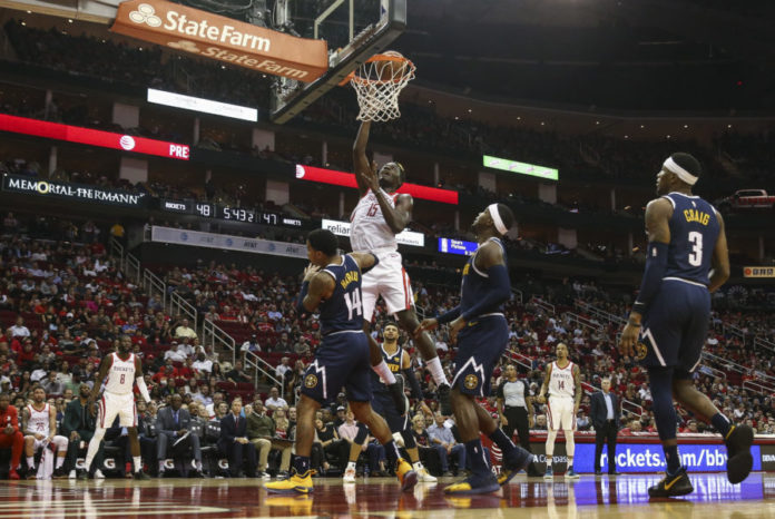 Houston Rockets center Clint Capela (15) attempts to score a basket against Denver Nuggets guard Gary Harris (14) during the second quarter at Toyota Center.