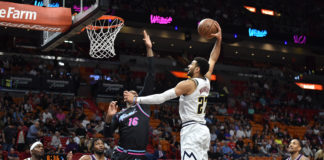 Denver Nuggets guard Jamal Murray (27) dunks the ball against Miami Heat forward James Johnson (16) at American Airlines Arena.