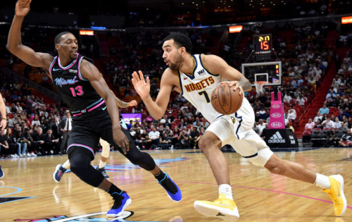 iami Heat center Bam Adebayo (13) pressures Denver Nuggets forward Trey Lyles (7) during the first half at American Airlines Arena.