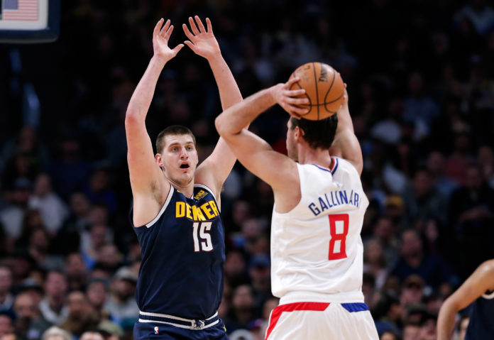 Denver Nuggets center Nikola Jokic (15) defends against Los Angeles Clippers forward Danilo Gallinari (8) in the second quarter at the Pepsi Center.