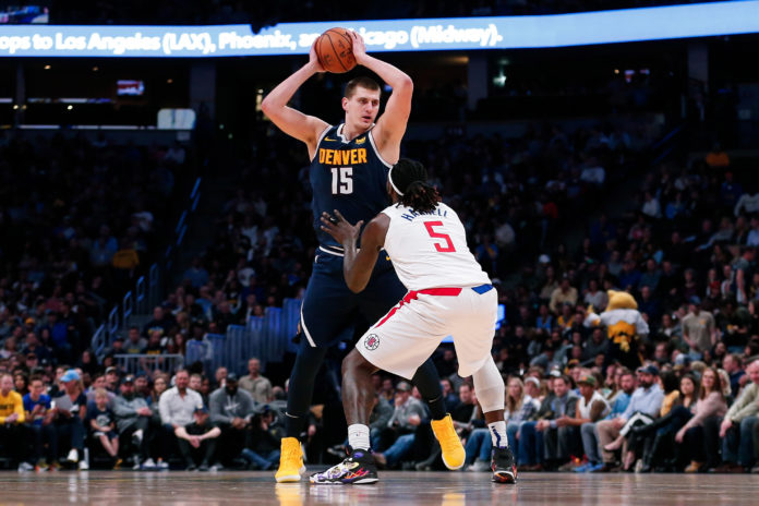 Los Angeles Clippers forward Montrezl Harrell (5) guards Denver Nuggets center Nikola Jokic (15) in the second quarter at the Pepsi Center.