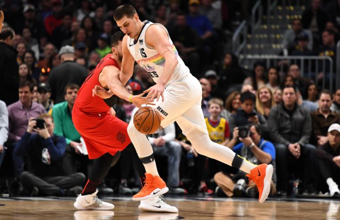 Portland Trail Blazers center Jusuf Nurkic (27) reaches in on Denver Nuggets center Nikola Jokic (15) in the first quarter at the Pepsi Center.