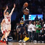 Denver, CO, USA; Denver Nuggets forward Torrey Craig (3) attempts a three point basket over Chicago Bulls guard Zach LaVine (8) in the first quarter of the game at the Pepsi Center.