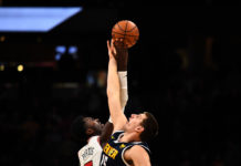 Chicago Bulls forward Bobby Portis (5) and Denver Nuggets center Nikola Jokic (15) reach during tipoff n the first quarter of the game at the Pepsi Center.
