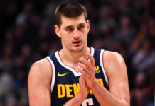 Denver Nuggets center Nikola Jokic (15) claps in the second half against the Chicago Bulls at the Pepsi Center.