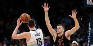 Cleveland Cavaliers center Ante Zizic (41) guards Denver Nuggets center Nikola Jokic (15) in the second quarter at the Pepsi Center.